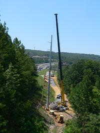 Using our Brand New Grove GMK 4115 115-Ton All-Terrain Hydraulic ATC ( All Terrain Crane ), we set 124' concrete utility poles.