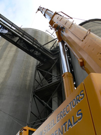 Repairs to Clinker Silo Roof Repair System. In service was a Liebherr LTM1160/2 200-Ton Hydraulic Truck Crane and one GKM 5175 175-Ton Hydraulic Truck Crane on this 170' tall storage silo